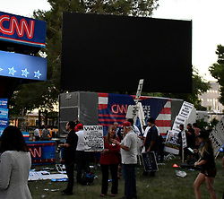 Oct 19, 2016. Las Vegas NV.  Protesters got screwed as CNN turn off the jumbotron and did not air the debate at the CNN booth at UNLV rally Wednesday. Today will be the 3rd and final presidential debate between Republican presidential nominee Donald Trump and Democratic presidential nominee Hillary Clinton at Las Vegas Nevada University. .Photo by Gene BlevinsZumaPress (Credit Image: © Gene Blevins via ZUMA Wire)