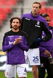 Stoke City's Joe Allen (left) and Peter Crouch warming up before the game