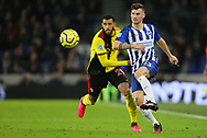 Brighton's Pascal Gross is challenged by Watford's Etienne Capoue during the Premier League match at the American Express Community Stadium, Brighton and Hove. Picture date: 8th February 2020. Picture credit should read: Paul Terry/Sportimage