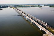 Nederland, Zuid-Holland, Hollandsch Diep, 04-07-2006;  binnenvaartschip passeert pijler nieuwe spoorbrug voor de HS(hogesnelheidslijn); de brug ligt naast de bestaande spoorburg: de Moerdijkbrug; de brug is ontworpen door Benthem Crouwel; onder in beeld Brabant, aan de horizon Zuid-Holland, met links aan de horizon het water van de de Dordtsche Kil, rechts van de brug de Dordtsche Biesbosch..Zie ook andere foto's van deze lokatie (lucht en panorama); deevan de serie Panorama Nederland..Barge passes pier for the new railway TGV (HST, the bridge is located next to the existing raibridge..Other aerial and panorama photos available, part of the series Panorama Nederland (major infrastucture photo project).luchtfoto (toeslag); aerial photo (additional fee required); .foto Siebe Swart / photo Siebe Swart