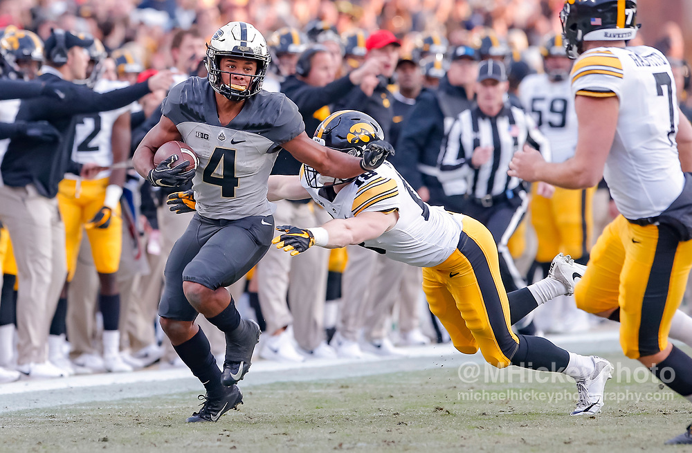WEST LAFAYETTE, IN - NOVEMBER 03: Rondale Moore #4 of the Purdue Boilermakers runs the ball during the game against the Iowa Hawkeyes at Ross-Ade Stadium on November 3, 2018 in West Lafayette, Indiana. (Photo by Michael Hickey/Getty Images) *** Local Caption *** Rondale Moore