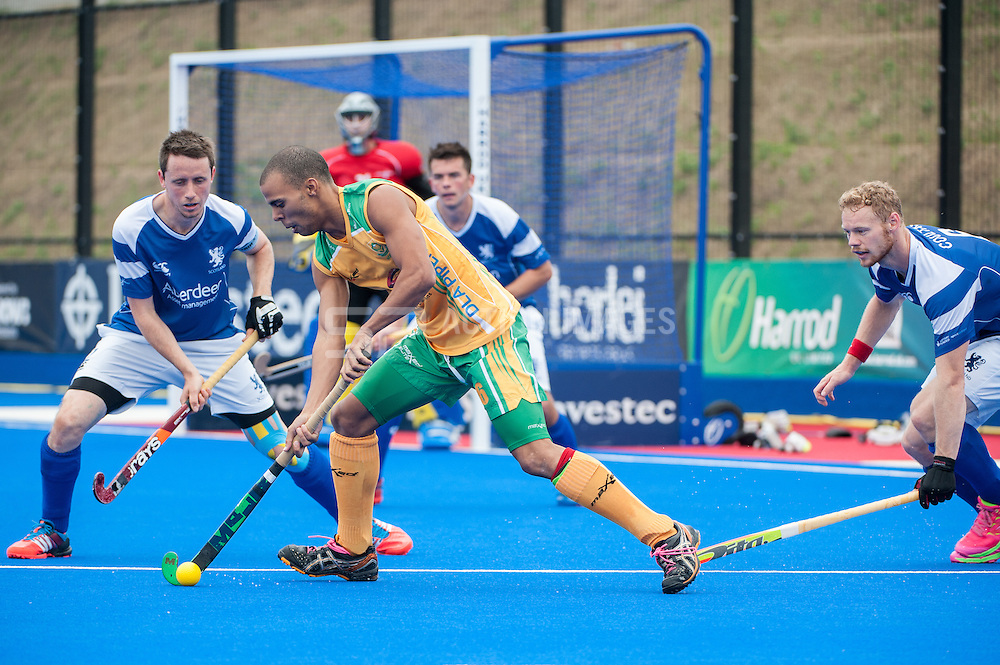 Ignatius Malgraff (RSA) is shadowed by Dan Coultas (SCO) and Chris Nelson (SCO). Scotland v South Africa, 3rd/4th play-off, Investec London Cup, Lee Valley Hockey & Tennis Centre, London, UK on 13 July 2014. Photo: Simon Parker