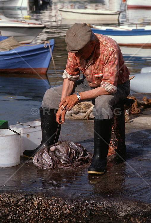 Fisherman with a collection of Octopus in Mykonos, Greece