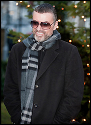 George Michael arrives back at his home in Highgate after spending a month in Hospital in Austria with influenza, Friday December 23, 2011. Picture by  i-Images