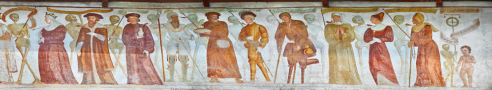 """The Church of San Vigilio in Pinzolo and its fresco paintings """"Dance of Death"""" painted by Simone Baschenis of Averaria in1539, Pinzolo, Trentino, Italy.<br /> <br /> The Mural depicts the living who have been pierced with arrows from skeletons waiting to see if they will go to heaven or to Purgatory of Hell .<br /> <br /> Visit our MEDIEVAL ART PHOTO COLLECTIONS for more   photos  to download or buy as prints https://funkystock.photoshelter.com/gallery-collection/Medieval-Middle-Ages-Art-Artefacts-Antiquities-Pictures-Images-of/C0000YpKXiAHnG2k<br /> If you prefer to buy from our ALAMY PHOTO LIBRARY  Collection visit : https://www.alamy.com/portfolio/paul-williams-funkystock/san-vigilio-pinzolo-dance-of-death.html"""