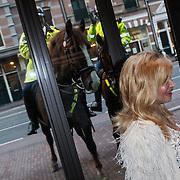 NLD/Amsterdam/20120420 - Show Joan Collins, Conny Breukhoven bekeken door 2 politiepaarden