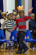 """Middletown, New York - A  student waves at the start of the """"YMCA Thanksgiving Day Spectacular"""" on the stage at the Center for Youth Programs on Nov. 27, 2013."""