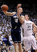 Brady Jardine of Utah State grabs a rebound as Noah Hartsock of BYU defends during the first half of an NCAA basketball game, Nov. 17, 2010 in Provo, Utah. (AP Photo/Colin E Braley)