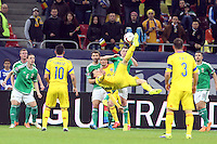 ROMANIA, Bucharest : Romania's Vlad Chiriches (C) vie for the ball during the Euro 2016 Group F qualifying football match Romania vs Northern Ireland in Bucharest, Romania on November 14, 2014.