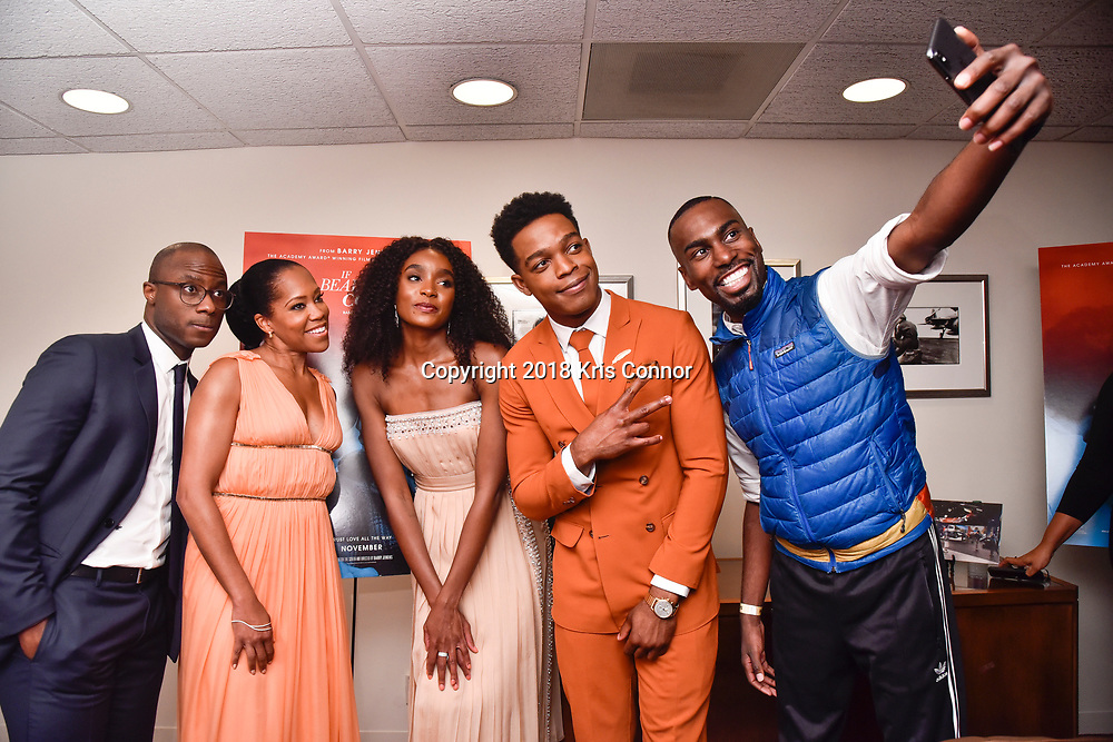 """WASHINGTON, DC - OCTOBER 27: DeRay  Mckesson(R) poses with Director/screenwriter Barry Jenkins and actors Regina Hall, Stephan James, and KiKi Layne during the closing night screening of """"IF BEALE STREET COULD TALK"""" at the inaugural Smithsonian African American Film Festival 2018 at National Air and Space Museum in Washington DC on October 27th, 2018. (Photo by Kris Connor/Annapurna Pictures)"""