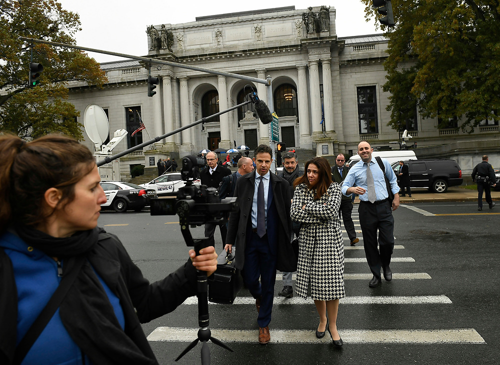 Attorney Josh Koskoff walks with Francine Wheeler mother of Sandy Hook shooting victim Ben Wheeler, outside the Connecticut state Supreme Court , Tuesday, Nov. 14, 2017, in Hartford, Conn.  Connecticut Supreme Court held the first hearing in the appeal filed by the families of nine Sandy Hook victims and one survivor in their case against the makers of the AR-15 used in the 2012 Newtown shooting. (Jessica Hill for the New York Times)
