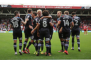 Derby team celebrate the first goal with Ikechi Anya (8) during the EFL Sky Bet Championship match between Bristol City and Derby County at Ashton Gate, Bristol, England on 17 September 2016. Photo by Gary Learmonth.