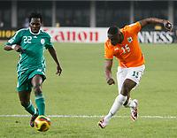 Photo: Steve Bond/Richard Lane Photography.<br />Nigeria v Ivory Coast. Africa Cup of Nations. 21/01/2008. Aruna Dindane (R) shoots before Apam Onyekachi (L) can close him down