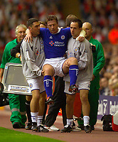 Photo. Jed Wee.<br /> Liverpool v Leicester City, FA Barclaycard Premiership, Anfield, Liverpool. 20/09/2003.<br /> Leicester's Craig Hignett is carried off early in the game.