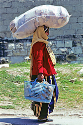 Woman Carrying Sack