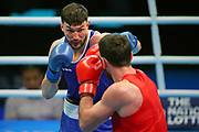 Afanasev Kirill of Ireland, (left) and Begadze Nikoloz of Georgia compete in the Men's Heavyweight preliminaries during The Road to Tokyo European Olympic Boxing Qualification, Sunday, March 15, 2020, in London, United Kingdom. (Mitchell Gunn-ESPA-Images/Image of Sport)