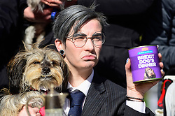 """© Licensed to London News Pictures. 10/03/2019. LONDON, UK. A Jacob Ree-Mogg look-alike poses.  Pro-Remain owners bring their dogs to Victoria Park Gardens, next to the Houses of Parliament, for """"Brexit is a Dog's Dinner"""", a protest to urge MPs to vote to ensure that a no-deal Brexit is avoided and to give the people of the UK a final say.  Next week, there will be a series of up to three votes in the House of Commons where MPs will vote on whether to accept Theresa May's Brexit deal.  Photo credit: Stephen Chung/LNP"""