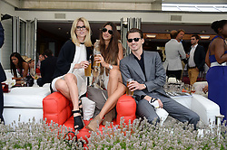 Left to right, ALICE EVE, LUPE ROLDAN and JACK EVE at the Audi International Polo at Guards Polo Windsor Great Park, Egham, Surrey on 28th July 2013.