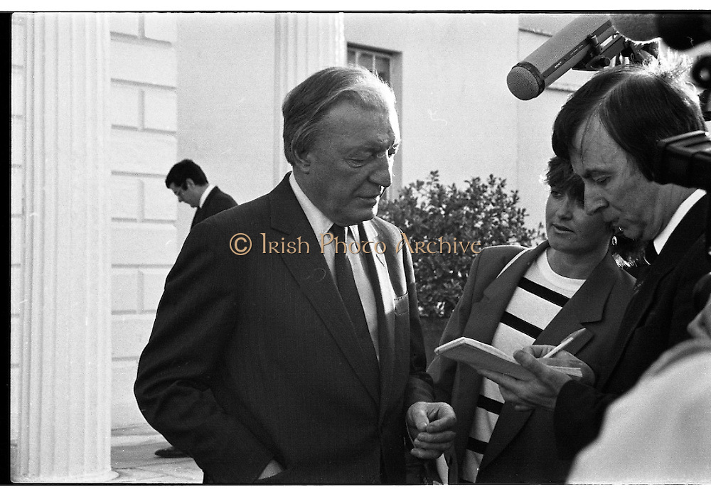 Dissolution Of The 25th Dáil.  (S4)..1989..25.05.1989..05.25.1989..25th May 1989..At the request of An Taoiseach,Mr Charles Haughey TD, President Patrick Hillery agreed to sign the order for the dissolution of the 25th Dáil. Fianna Fáil the outgoing government held the majority at 81 seats. This signing formally began the general election campaign for the 26th Dáil...Image shows Mr Charles Haughey TD stopping to have a few words with the media after the signing of the order to dissolve the 25th Dáil.