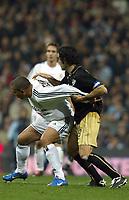 7/2/2004 Madrid, Spain.<br />La Liga (Spanish League) stage 23<br />R.Madrid 2 - Malaga 1<br />R.Madrid's Ronaldo in duel with Malaga's Fernando Sanz at Santiago Bernabeu's Stadium.<br />© 2004 Alejandro leon Fernandez