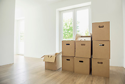 Cardboard boxes pile stack new home empty room