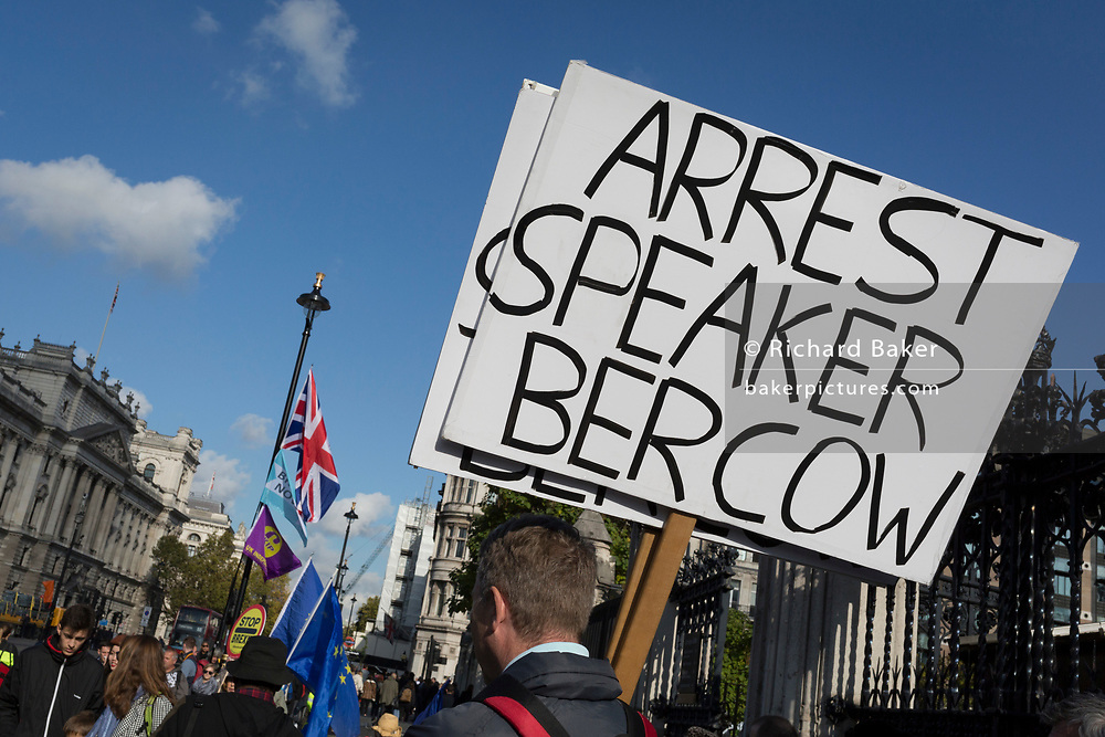 """Twenty-four hours day after the House of Commons Speaker John Bercow refused a government request to hold a """"yes"""" or """"no"""" vote on its Brexit deal, a Brexiteer's placard calls for his arrest, on 22nd October 2019, in London, England. Bercow had said a motion on the deal had been brought before MPs on (Super) Saturday when MPs had sat (to vote for Boris Johnson's Brexit deal), for the first time in 37 years, saying it would be """"repetitive and disorderly"""" to debate it again. Bercow has also historically been accused of bias by Conservatives and Brexit supporters."""