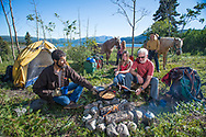 Trail riding, by horse, into the Yukon back country. Promotional photography for all web and print products.