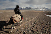 Ismoil, son in law of Abdul Hameed, going on horse back to round up the yaks. At the Andemin camp...Trekking through the high altitude plateau of the Little Pamir mountains, where the Afghan Kyrgyz community live all year, on the borders of China, Tajikistan and Pakistan.