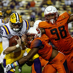 Sep 23, 2017; Baton Rouge, LA, USA; Syracuse Orange defensive back Christopher Fredrick (3) and defensive lineman McKinley Williams (98) tackle LSU Tigers quarterback Danny Etling (16) during the fourth quarter of a game at Tiger Stadium. LSU defeated Syracuse 35-26. Mandatory Credit: Derick E. Hingle-USA TODAY Sports