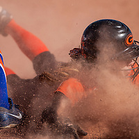 042313       Cable Hoover<br /> <br /> Gallup Bengal Patricia Lasiloo (8) dives into third base at the feet of Los Lunas Tiger Alliana Madrid (1) Tuesday at Gallup High School.
