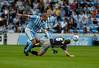 Photo: Leigh Quinnell.<br /> Coventry v Reading. Coca Cola Championship.<br /> 10/09/2005. Coventrys James Scowcroft clashes with Readings Brynjar Gunnarson