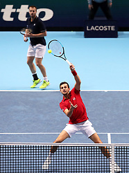 Oliver Marach and Mate Pavic during the doubles match during day six of the Nitto ATP Finals at The O2 Arena, London. PRESS ASSOCIATION Photo. Picture date: Friday November 16, 2018. See PA story TENNIS London. Photo credit should read: John Walton/PA Wire. RESTRICTIONS: Editorial use only, No commercial use without prior permission.