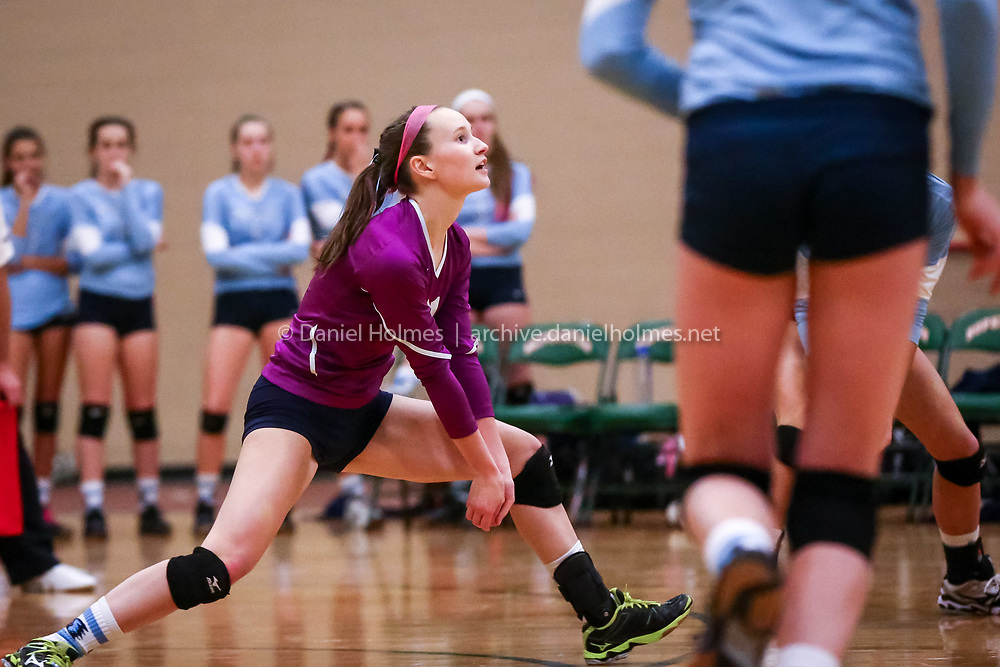(11/9/15, HOPKINTON, MA) Medfield's Abby Spaeth bumps the ball over the net during the tournament volleyball match against Hopkinton at Hopkinton High School on Monday. Daily News and Wicked Local Photo/Dan Holmes