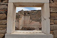 A window of a home  in the ruins of Delos Island in Greece.  Photograph by Dennis Brack