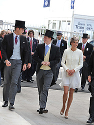 Left to right, HRH THE DUKE OF CAMBRIDGE, PRINCE HARRY and HRH The DUCHESS OF CAMBRIDGE at the Investec Derby at Epsom Racecourse, Epsom Downs, Surrey on 4th June 2011.