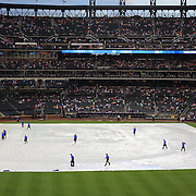 Ground staff prepare the field after a rain delay before the New York Mets V Arizona Diamondbacks Major League Baseball game  at Citi Field, Queens, New York. USA. 3rd July 2013. Photo Tim Clayton