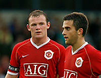 Photo: Glyn Thomas.<br /> Macclesfield Town v Manchester United. Pre Season Friendly. 31/07/2006.<br /> Manchester United's Wayne Rooney (L) and Giuseppe Rossi.