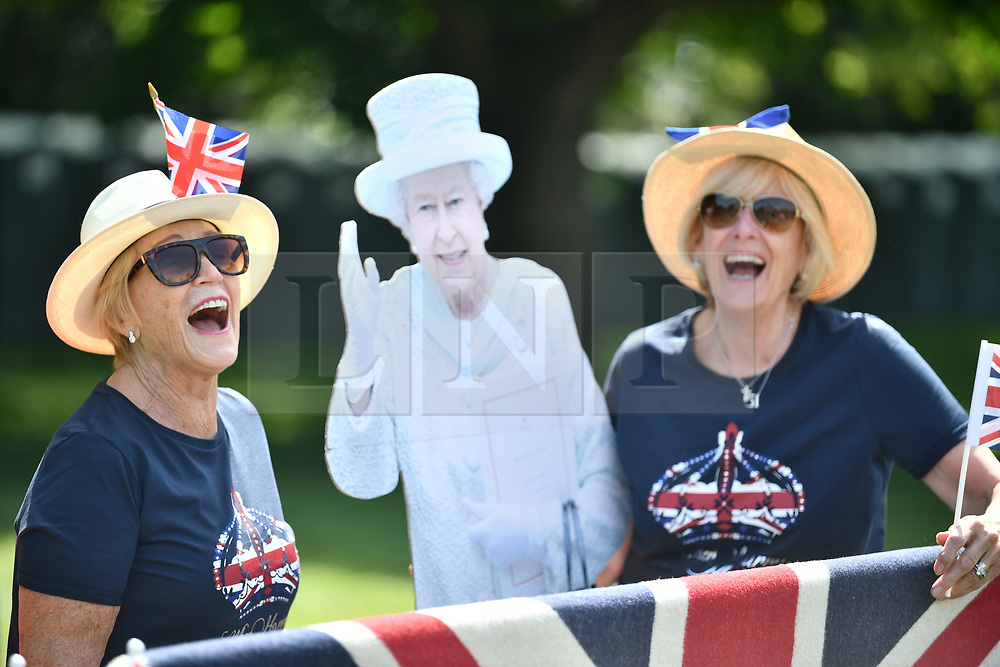 © Licensed to London News Pictures. 18/05/2018. London, UK. Royal fans gather on The Long Walk outside Windsor Castle. Prince Harry and Meghan Markle are to be married tomorrow (Saturday) at St George's Chapel in Windsor. Photo credit: Ben Cawthra/LNP
