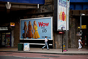 Advertising poster promotes an inexpensive dress for just £15 through Boohoo.com. In times of austrerity and economic downturn cheap goods are more than welcome and affordable. London.
