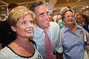 0913111550mm romney - 14 SEPTEMBER 2011 - SUN LAKES, AZ: Linda Schude (CQ) from Sun Lakes, has her picture taken with Mitt Romney (CQ) at the Oakwood Clubhouse at Sun Lakes Wednesday. Romney was one of the first of the 2012 Republicans running for the GOP Presidential nomination to come to Arizona. He campaigned Wednesday in Tucson and Sun Lakes and attended a private event in Tempe.    ARIZONA REPUBLIC PHOTO BY JACK KURTZ