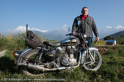 Danny Ochs poses with a spectacular background of 23,000' peaks on day-4 our our Himalayan Heroes adventure riding from Pokhara to Kalopani, Nepal. Friday, November 9, 2018. Photography ©2018 Michael Lichter.