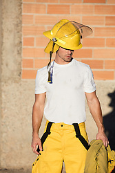 sexy young fireman outdoors at sunset