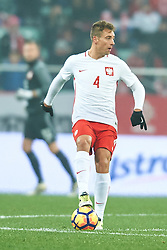 Wroclaw, Poland - 2016 November 14: Thiago Cionek of Poland controls the ball during Poland v Slovenia - International Friendly Soccer Match at Municipal Stadium on November 14, 2016 in Wroclaw, Poland.<br /> <br /> Adam Nurkiewicz declares that he has no rights to the image of people at the photographs of his authorship.<br /> <br /> Picture also available in RAW (NEF) or TIFF format on special request.<br /> <br /> Any editorial, commercial or promotional use requires written permission from the author of image.<br /> <br /> Mandatory credit:<br /> Photo by © Adam Nurkiewicz / Mediasport