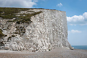 The cliff edge of Seven Sisters Cliffs next to Cuckmere Haven beach on the 25th of August 2021 near Seaford, East Sussex, United Kingdom. The Seven Sisters are a series of chalk cliffs by the English Channel. They form part of the South Downs in East Sussex, between the towns of Seaford and Eastbourne in southern England. Cliff falls are common along these cliffs as they are formed from chalk.