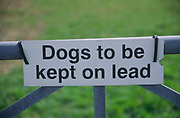 ADD2X8 Sign saying Dogs to be kept on lead on a farm gate