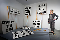 © Licensed to London News Pictures. 05/01/2018. Wakefield UK. Curator Helen Pheby looks at the 1993 piece by Martin Boyce called 'Souvenir placards' at the new exhibition called Revolt & Revolutions is opening at Yorkshire Sculpture Park, drawn from the arts council collection, it gives an insight into counterculture & anti-establishment movements, and shows the work of artists who seek to make a difference- helping to suggest ways that we might contribute to change on an individual, community & global level. Photo credit: Andrew McCaren/LNP