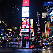 """Times Square, the major commercial intersection in Midtown Manhattan, New York City, at the junction of Broadway and Seventh Avenue and stretching from West 42nd to West 47th Streets. Times Square, iconified as """"The Crossroads of the World"""" is the brightly illuminated hub of the Broadway theater district and one of the world's busiest pedestrian intersections. Times Square, New York, USA. Photo Tim Clayton"""