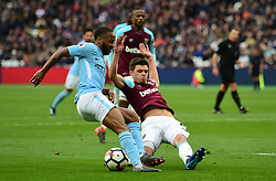Aaron Cresswell of West Ham United brings down Raheem Sterling of Manchester City in the box. - Mandatory by-line: Alex James/JMP - 29/04/2018 - FOOTBALL - London Stadium - London, England - West Ham United v Manchester City - Premier League