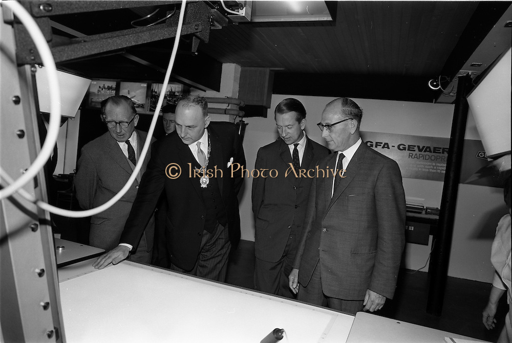 """19/09/1967<br /> 09/19/1967<br /> 19 September 1967<br /> Opening of Agfa-Gevaert exhibition at the Building Centre, Lower Baggot Street, Dublin. Exhibition """"Microfilms in the Space Age"""" demonstrating microfilming equipment and facilities, most of the equipment was exclusive to Agfa-Gevaert Limited. Pictured (l-r) are: Mr Heinrich Toebelman, Commercial Councillor of the (West) German Embassy; The Lord Mayor of Dublin, Alderman Tom Stafford; M. Baudouin Verhaeren, Charge d'Affaires, Belgian Embassy and Mr Patrick Howard,General Manager, Agfa-Gevaert Ltd., viewing some of the equipment."""