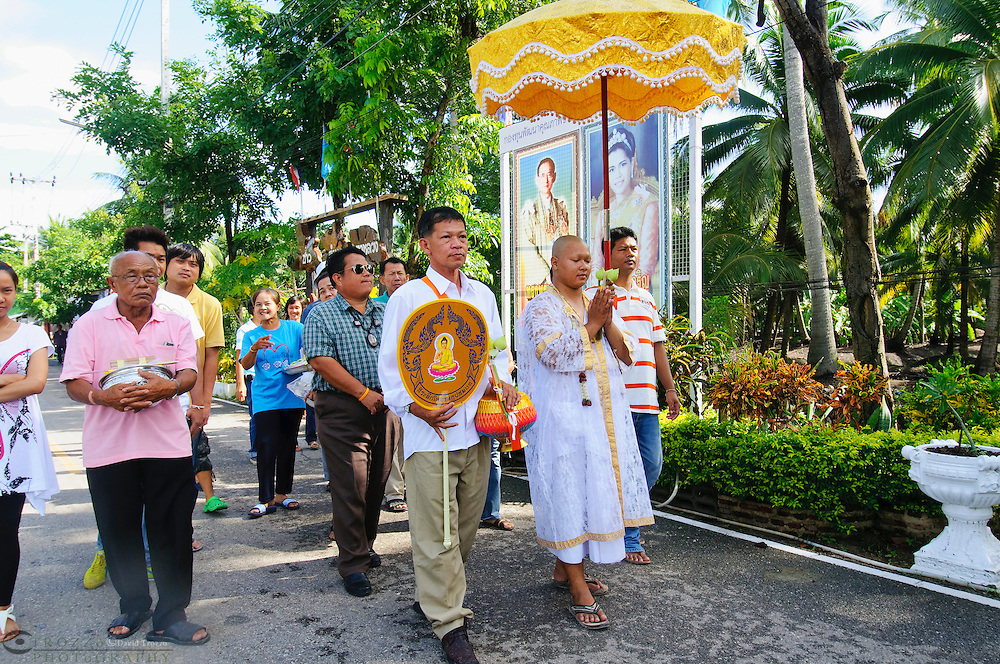 Buddhist novice ordination ceremony for new monk, Watt Prok a Buddhist Temple at Ta Luang Thailand near Damnoen Saduak